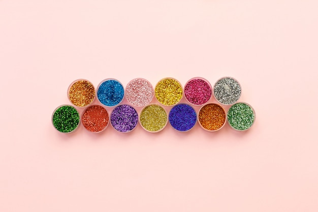 Glitter and sequins for makeup and nail design in transparent jars.