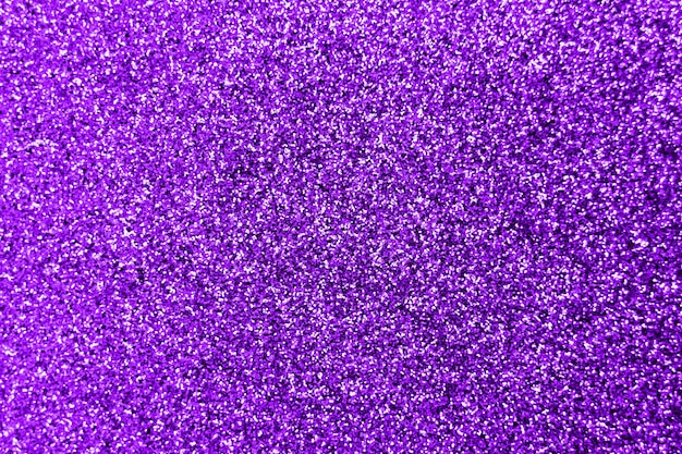 Glitter splash and lens flare on purple shiny trendy