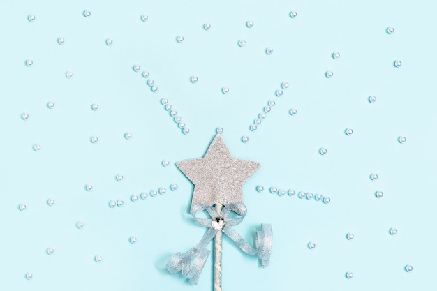 Glittering star on blue with beads, magic star, fulfillment of wishes, dreams