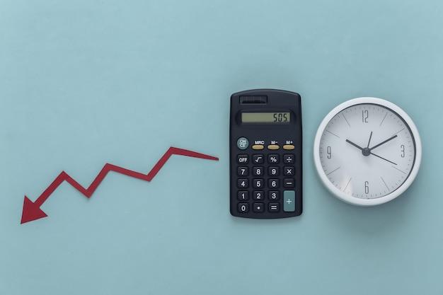 Global crisis theme. calculator with clock, falling arrow tending down on blue