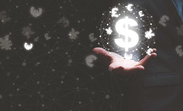 グローバルな外貨両替のコンセプト、仮想ライン効果とドル元円ユーロとポンドのスターリングサインを備えた手持ちの世界。
