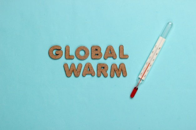 Global warming concept. thermometer on blue