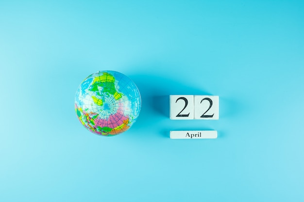 Globe and 22th april calendar. happy earth day and environment concept