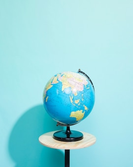 Globe on blue background with copyspace