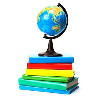 Globe on books isolated over white