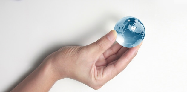 Globe ,earth in human hand, holding our planet glowing.