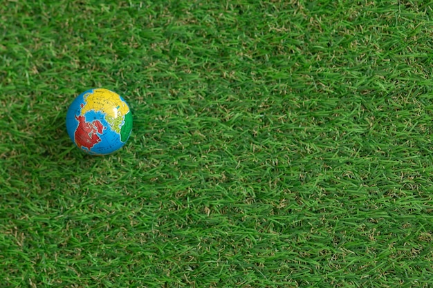 A globe on the lush green grass. earth day. planet earth