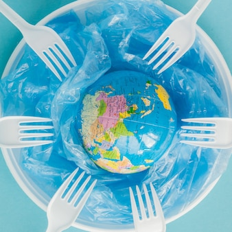 Globe on a plastic plate. the concept of ecology, land conservation