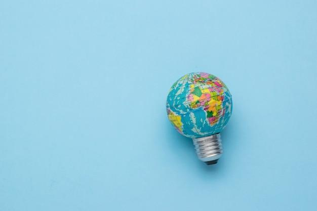 A globe-shaped light bulb on a light blue background.