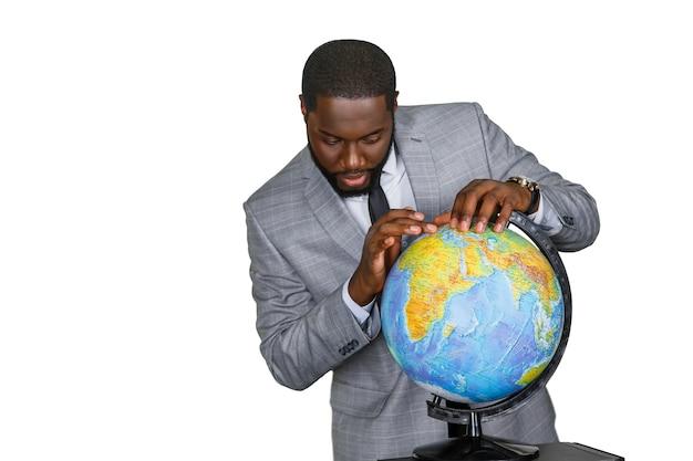 The globe in teacher's hands.