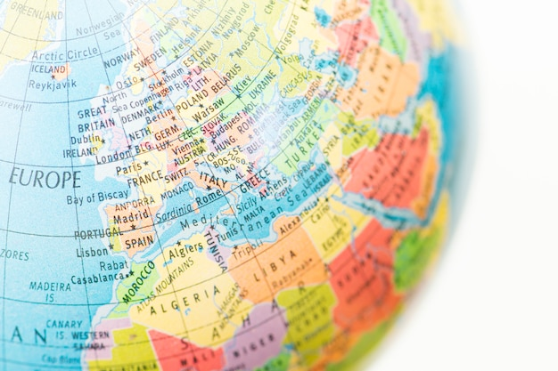 A globe with map of europe background