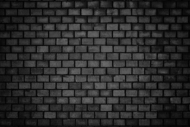 Gloomy, black brick wall of dark stone texture