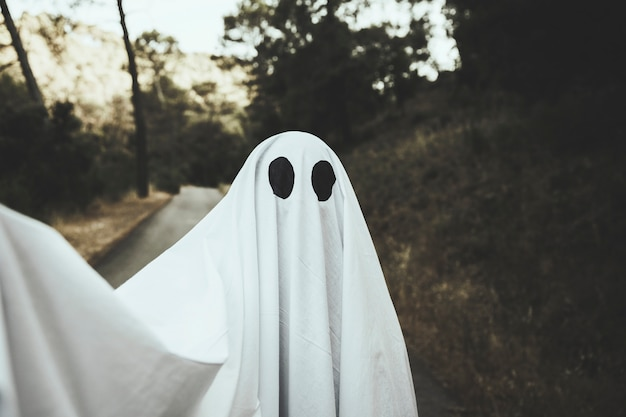 Gloomy ghost doing selfie on park