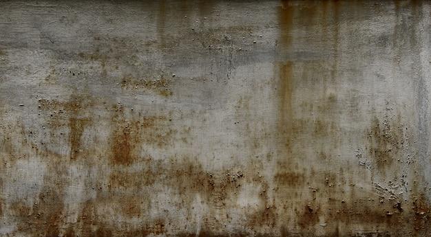 錆びた汚れのある暗い灰色の壁