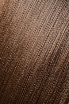 Glossy brown hair texture, background. close view of long straight women's hair. hair care concept.
