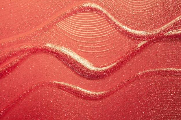 Глянцевая золотисто-оранжевая текстура помады размазана