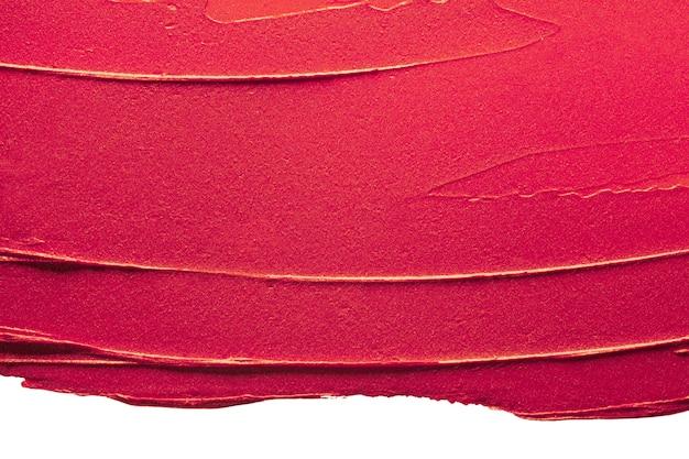 光沢のある赤い口紅の背景のテクスチャが汚れています