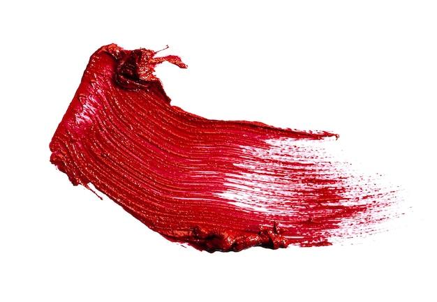 白い背景で隔離の光沢のある赤い口紅の染み見本