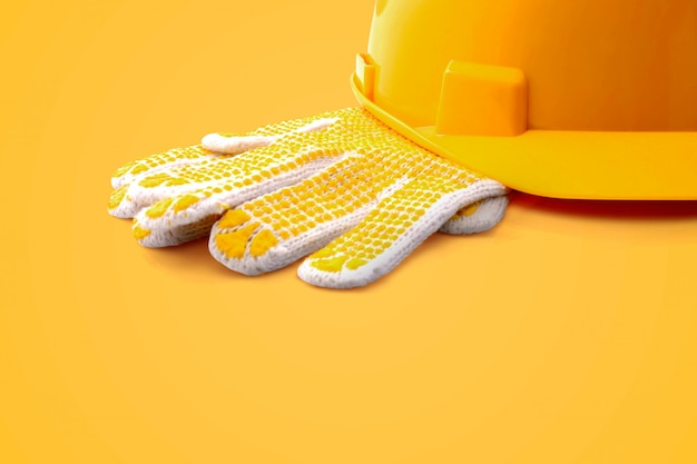 Glove and safety helmet in vibrant color