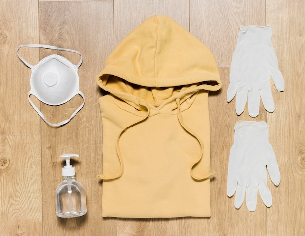 Gloves and desinfectant beside hoodie