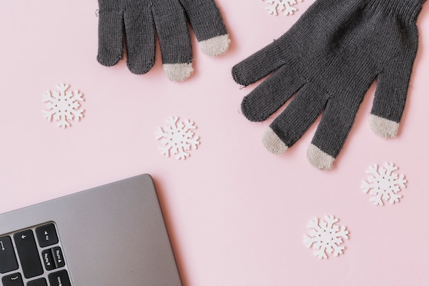 Gloves with small snowflake on table