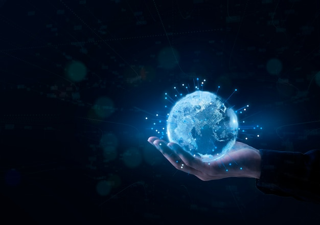 Glow earth particle was holding in human hands. big data technology concept.