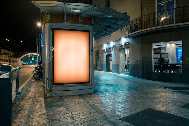 Glowing billboard for the advertisement on the sidewalk