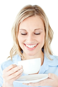 Glowing businesswoman holding a cup of coffee