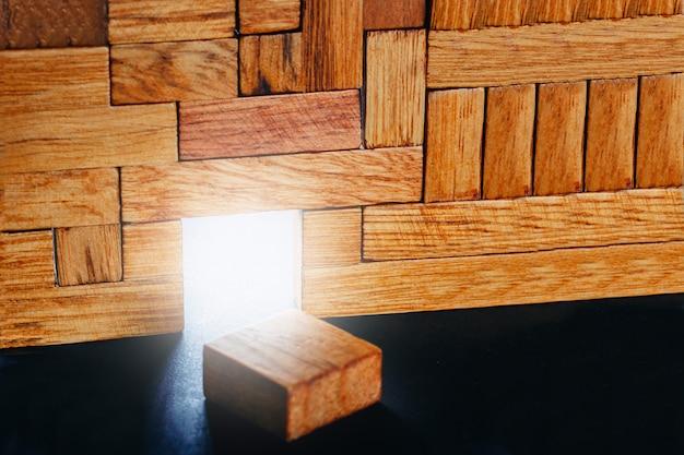 Glowing doorway in the construction of different wooden blocks.