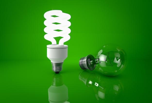 緑の背景に光る省エネ電球と暗い白熱電球。省エネのコンセプト。