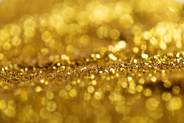 Glowing gold sparkles in light