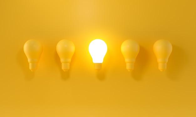 Светящаяся лампочка между другими на желтом светлом фоне. лидерство, инновационные концепции.