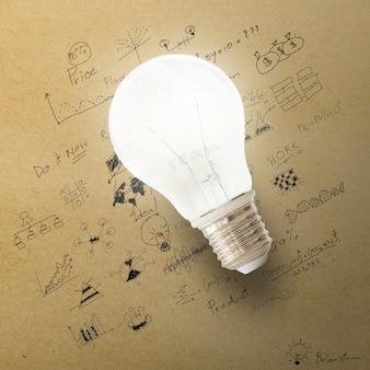 Glowing Light bulb on the drawing of business strategy plan.