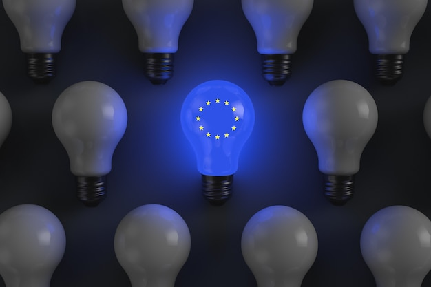 Glowing light bulb with the symbols of the european union political economy theme