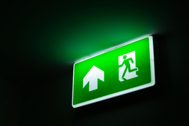 Glowing sign indicating the exit from the room.