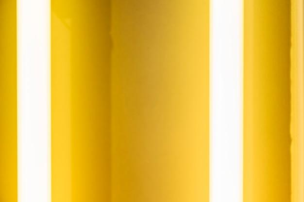 빛나는 노란색 네온 튜브 질감 배경