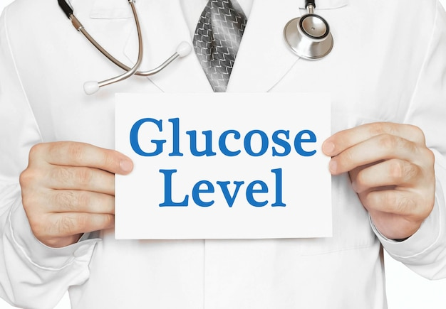 Glucose level card in hands of medical doctor