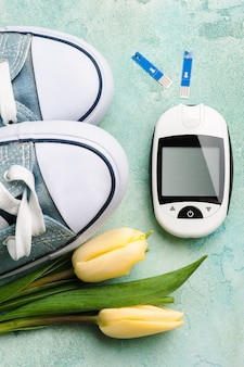 Glucose meter, gumshoes and tulips