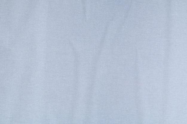 不織布ベースの接着紙テクスチャ灰色の壁。創造的な抽象的な背景。