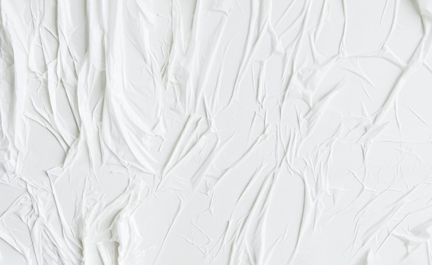 Glued wall white paper with air pockets. white uneven wrinkled textured background.