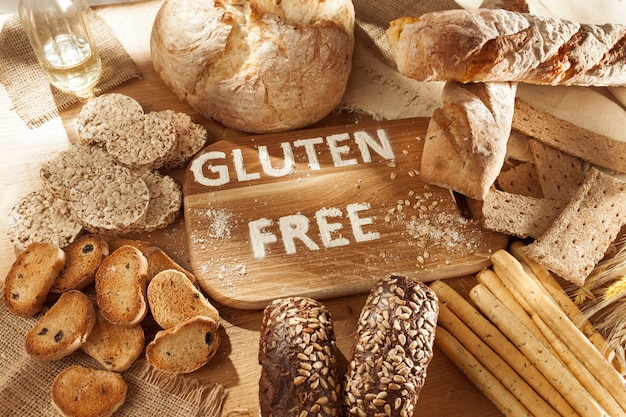Gluten free food. various pasta, bread and snacks on wooden