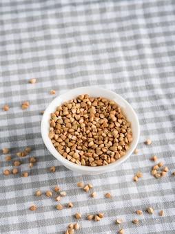 Gluten free grain buckwheat in bowl on kitchen table