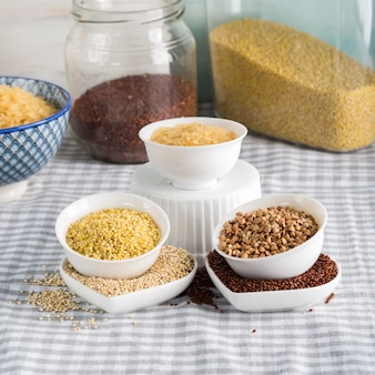 Gluten free grains in bowls on kitchen table