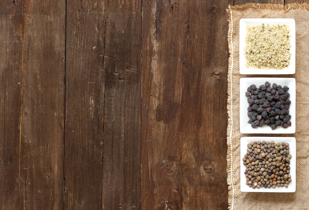 Gluten free grains in bowls on wood top view with a copy space