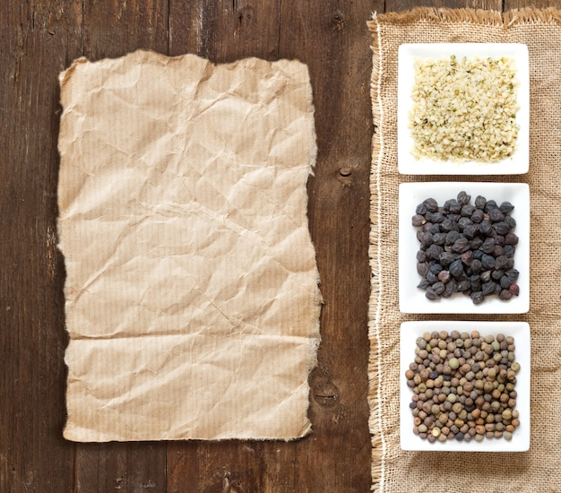 Gluten free grains in bowls on wood top view with a paper