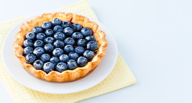 Gluten free tart with blueberry jam and ripe berries
