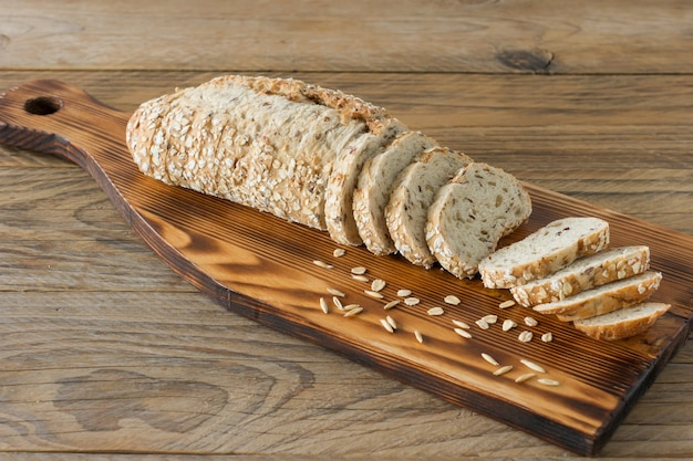 Gluten-free vegan bread and no animal products. vegetarian bread with oatmeal, banana flavor, on a wooden rustic table, sliced and ready to serve.
