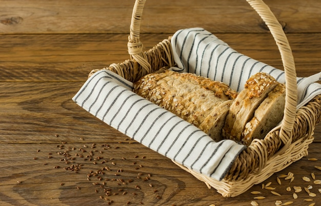 Gluten-free vegan bread with no animal products. vegetarian bread with oatmeal, banana flavor in a basket on a wooden rustic table, sliced and ready to serve.