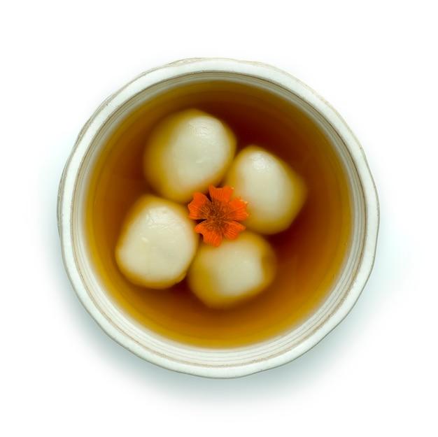 Glutinous rice balls inside black sesame in sweet ginger