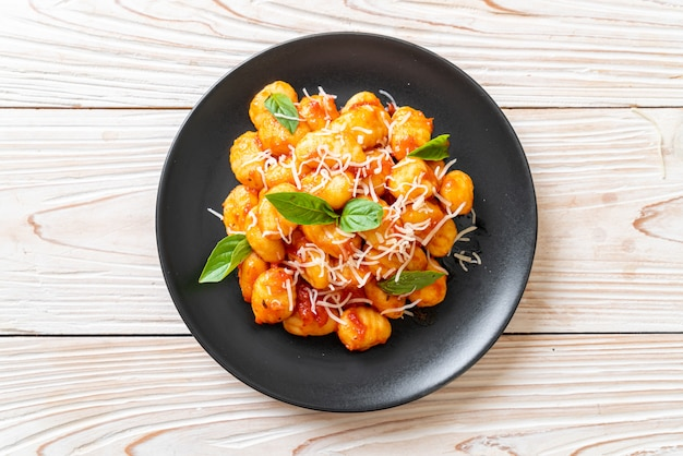 Gnocchi in tomato sauce with cheese